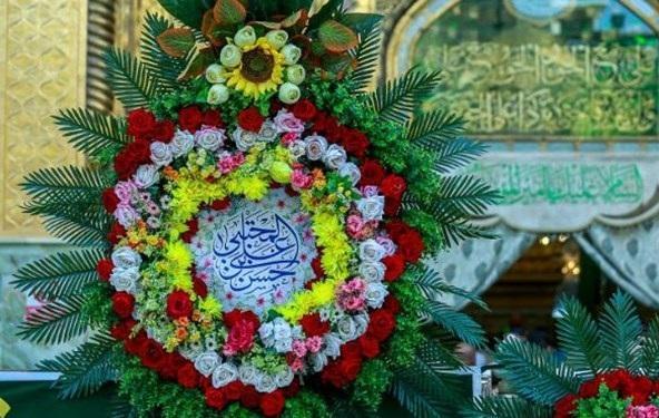 پرچم مزین به نام امام حسن (ع) در ایوان نجف برافراشته شد